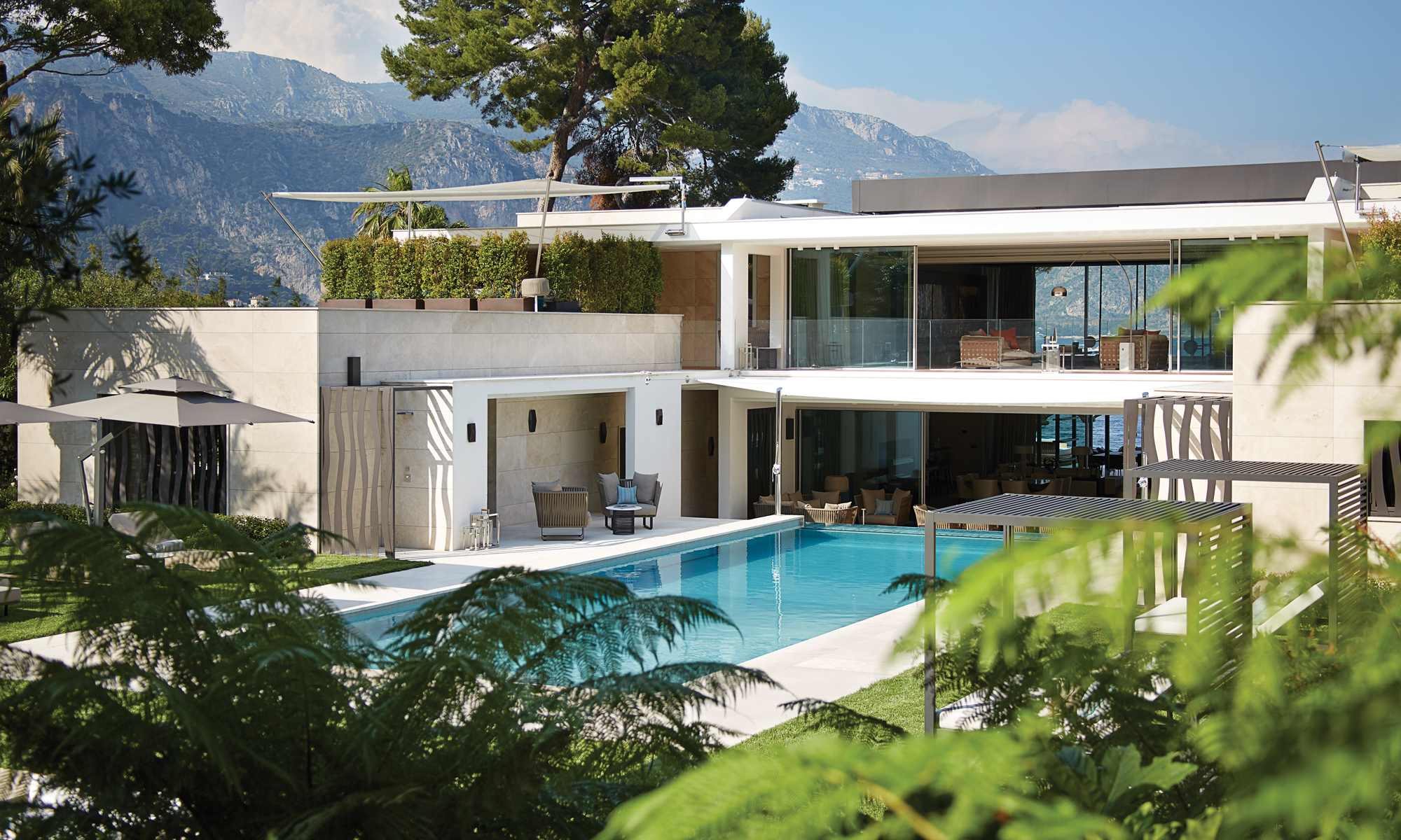 Villa L'Empyrée is set out over more than 4,200 sq m of manicured gardens, featuring two outdoor heated swimming pools.