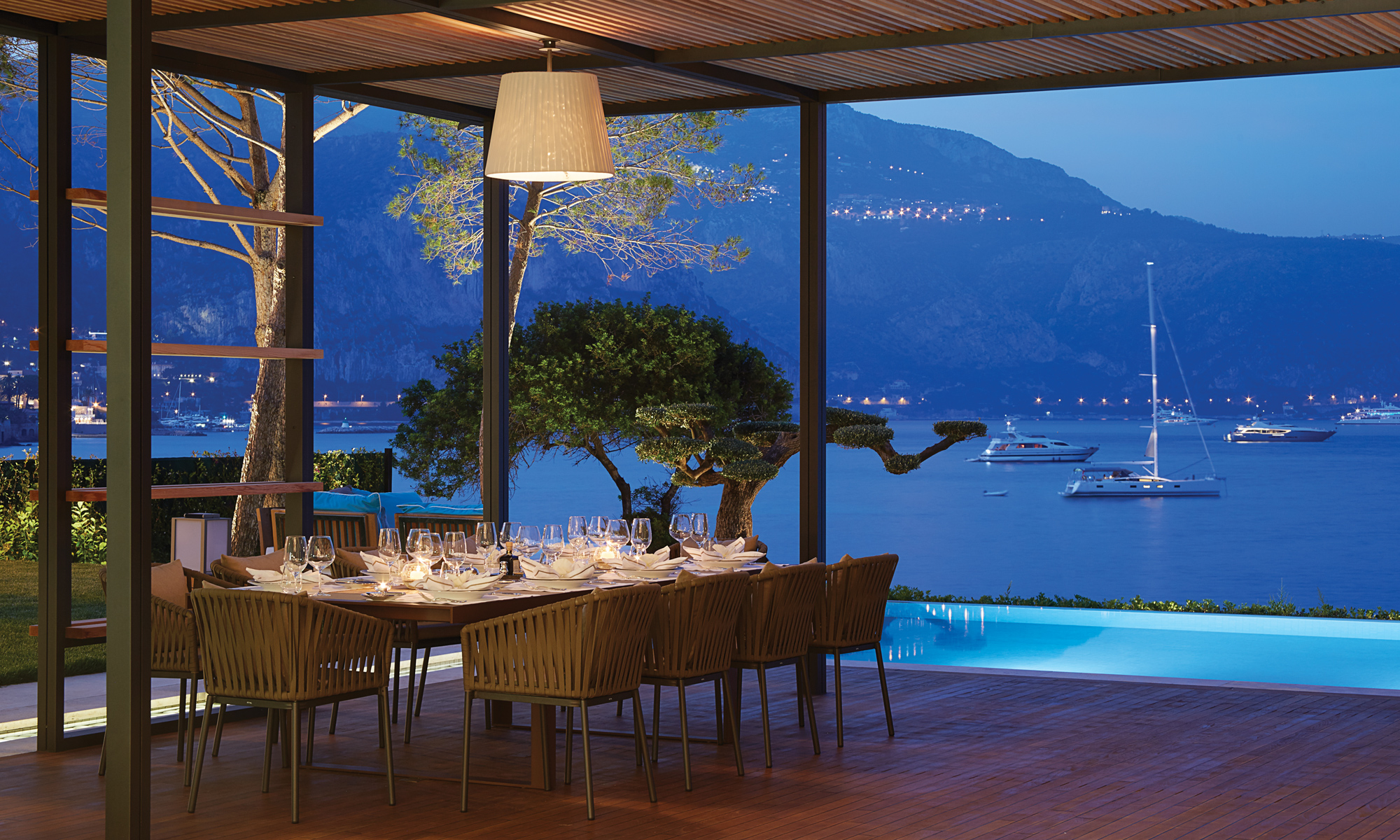 Evening dining on the terrace provides breath-taking views across the bay.