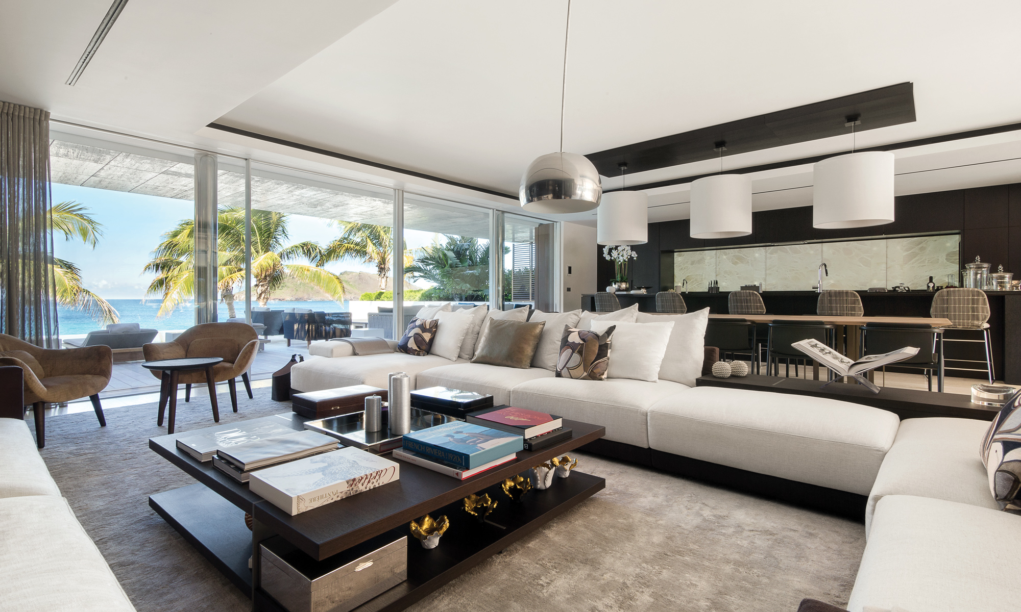 Spacious open plan living and dining area with direct views out onto Flamands beach.